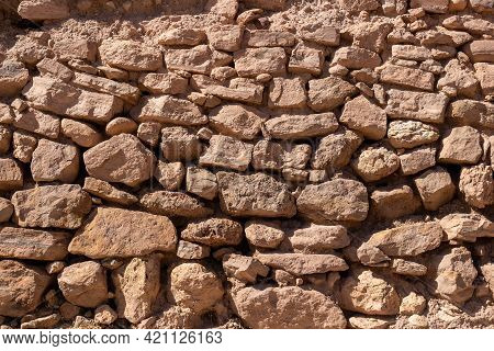 Masonry Texture From Large Rough Red Stones. Weathered Stone Wall For Background