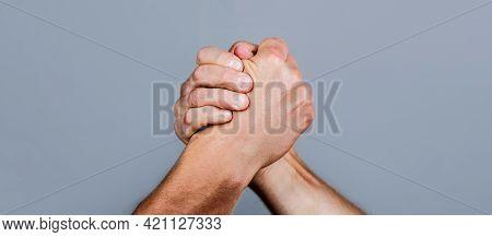 Two Men Arm Wrestling. Arms Wrestling. Closep Up. Friendly Handshake, Friends Greeting, Teamwork, Fr