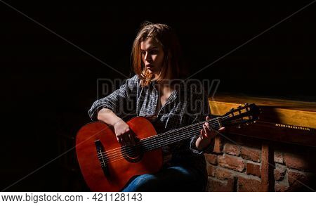 Girl Play The Guitar. Woman Hipster Man Sitting In A Pub. Woman Playing Guitar, Holding An Acoustic