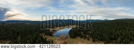 Aerial Panoramic View Of A Lake In The Canadian Landscape. Cloudy And Sunny Spring Sunset. Taken Nea