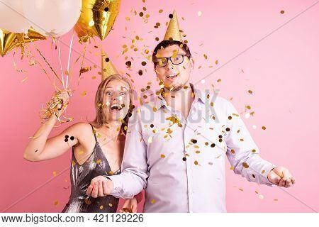 Birthday Party. Funny Couple Celebrating Birthday. Happy Laughing Couple Celebrating Birthday Party