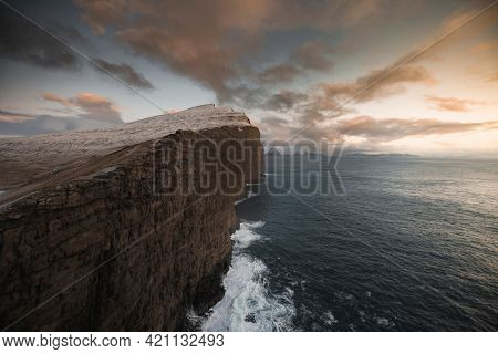 Sunset over the Slave cliff in Faroe islands