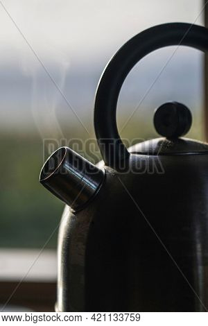 Kettle on a stove in the kitchen