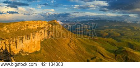 Aerial panorama view of plateau Bermamyt and hills at sunset, North Caucasus mountains, Russia.