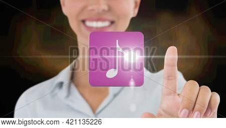 Composition of musical note on pink tile over midsection of smiling woman using virtual interface. global communication technology digital interface concept, digitally generated image.