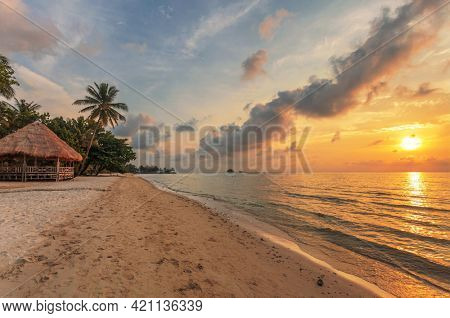 bungalow on a tropical beach at sunset. Thailand