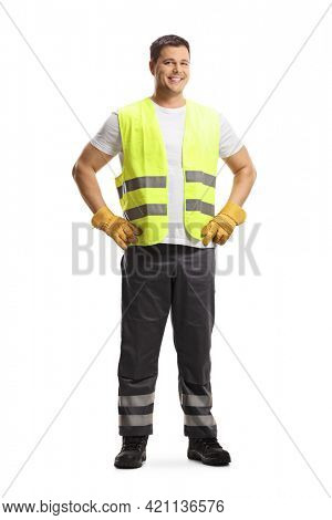 Full length portrait of a waste collector in a uniform and gloves isolated on white background