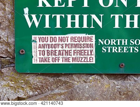 Weston-super-mare, Uk - April 20, 2021: A Sticker Opposing The Use Of Masks Attached To A Sign At Th
