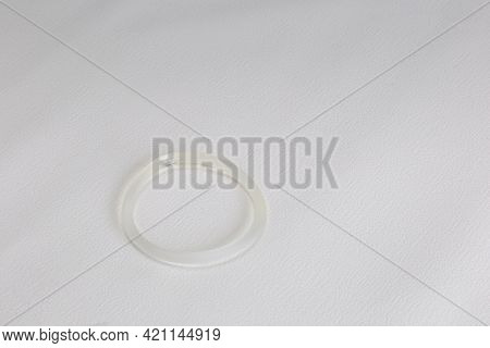 Band Birth Control, Hormone, Contraception For Woman On White Background, Vaginal Ring With Copy Spa