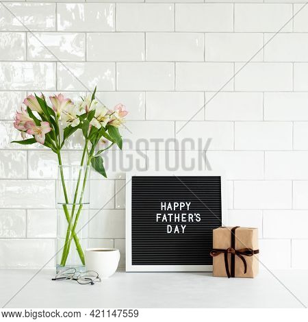 Happy Fathers Day Concept. Letterboard With Sign Happy Father's Day, Gift Box, Boquet Of Flowers, Co