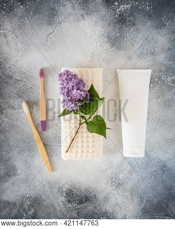 Natural, Dental Hygiene Composition With Toothbrushes, Tube With Toothpaste And Fresh Sprig Of Lilac
