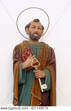 MIHOVLJAN, CROATIA - JULY 15, 2013: Saint Peter statue in the parish church of Saint Michael the Archangel in Mihovljan, Croatia