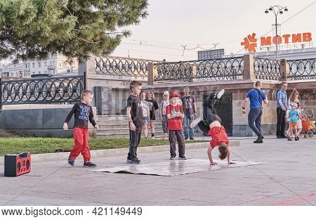 Yekaterinburg, Russia - May 15, 2021: Boys Are Dancing Breakdance On A City Street. The Solo Child I