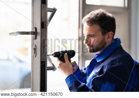 Locksmith Man Repairing And Changing Metal Door Lock