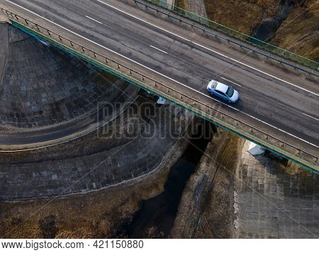 Moscow , Russia - SPT 29, 2020:   Highway intersection junction summer morning with white car. Aerial Top View