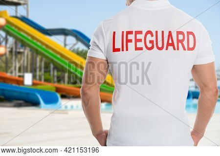 Safeguard And Sport Recreation Coach. Poolside Rescuer