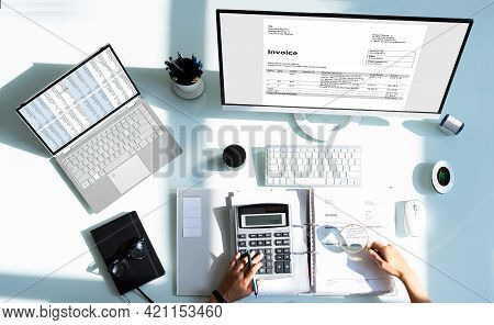 Accountant Using Calculator And Computer For E Invoice Audit