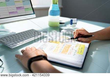 Looking At Calendar Schedule And Agenda In Appointment Organizer