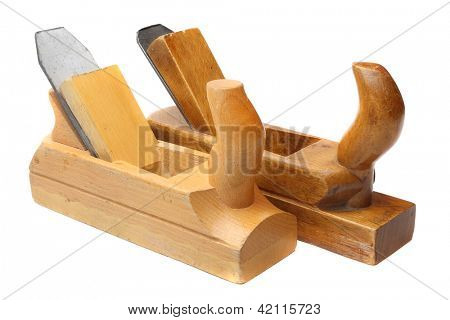 Old wooden planers isolated on a white background.