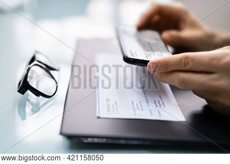 Taking Remote Deposit Payroll Cheque Document Picture