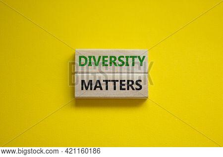 Diversity Matters Symbol. Wooden Blocks With Words 'diversity Matters' On Beautiful Yellow Backgroun