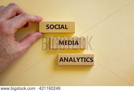 Social Media Analytics Symbol. Wooden Blocks With Words 'social Media Analytics' On Beautiful White