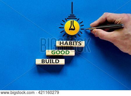 Build Good Habits Symbol. Wooden Blocks With Words 'build Good Habits'. Businessman Hand. Light Bulb