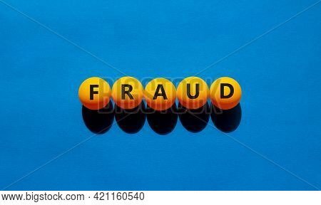 Fraud Symbol. Orange Table Tennis Balls With The Words 'fraud'. Beautiful Blue Background, Copy Spac