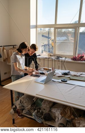 Tailoring Small Business And Designers Teamwork. Two Creative Dressmaker Work In Studio With Fabric