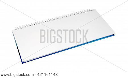 Empty White Notepad With White Spiral Wire Binding And Blue Cover. Isolated On White Background