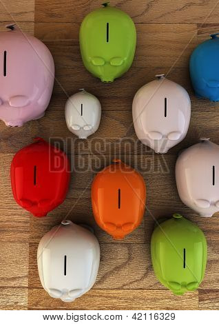 Colorful Plastic Pig Money Boxes On Wooden Floor - Saving Money Concept