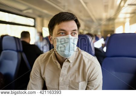Travel Safely Covid 19 On Public Transport. Train Passenger With Protective Mask Travels Sitting On