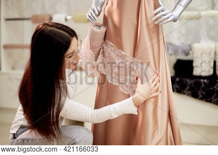 Fashion And Tailoring Concept. Caucasian Brunette Female Designer Or Tailor Working With New Model A