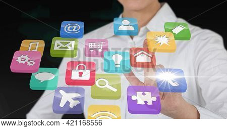 Composition of businesswoman touching screen with digital colouruful icons. global communication, technology and digital interface concept digitally generated image.