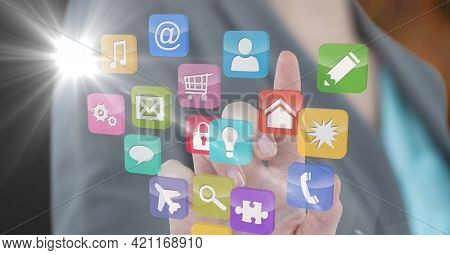 Composition of businesswoman touching screen with digital colourful icons. global communication, technology and digital interface concept digitally generated image.