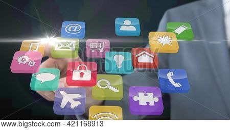 Composition of businessman touching screen with digital colouruful icons. global communication, technology and digital interface concept digitally generated image.