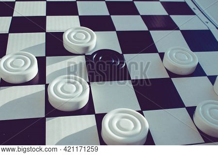Board Game Of Checkers. Black And White Chips For The Game. Chess Field. Checkers Move Close-up. Che
