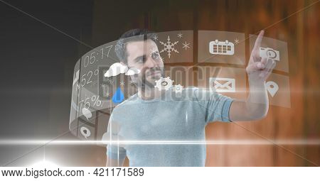 Composition of man with screens and digital icons on screen. global technology and digital interface concept digitally generated image.