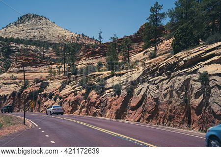 Utah, Usa - May 16, 2021: Cars Drive Along The Zion-mt. Carmel Scenic Highway In Zion National Park