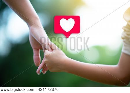 Likes and blogging at social networks. Woman's and kid's hands. Mother lead her child, summer nature outdoor. Parenting, togetherness, help, union, childhood, trust, family concept.