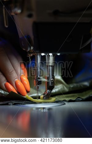 Woman Tailor Work On Sewing Machine Stitching Patterns Of New Collection. Closeup Shot Of Female Sew