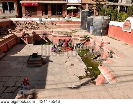 Life Of Nepali People Wait Queue For Receive Water In Ancient Building Antique Pool Pond After Earth