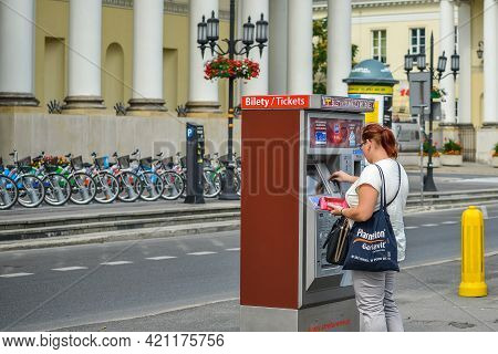 Warsaw. Poland - August 2015: A Girl Buys A Ticket At The Ztm Vending Machine For Public Transport I