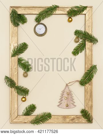 Christmas Old Wooden Frame With Green Fir Tree Branches, Golden Christmas Balls. Happy New Year Holi
