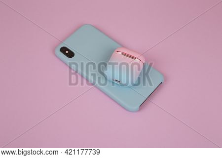 Phone In A Silicon Case And A Case For Headphones On A Lilac Background. Stylish Phone And Headphone