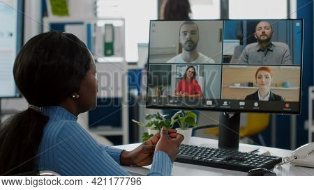 Immobilized Black Project Manager In Wheelchair Talking On Videocall During Online Meeting Discussin