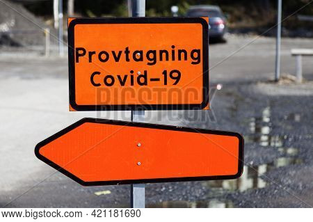 Orange Sign With The Text: Sampling Covid 19