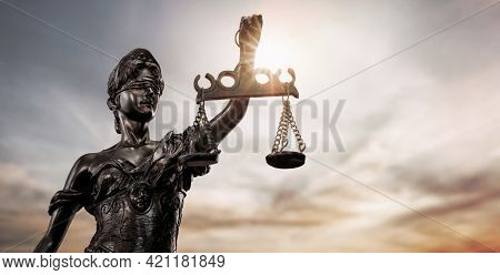Close Up Of Lady Justice, Themis Bronze Figure Over The Sky Background With Copy Space