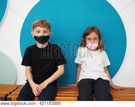 School Children Wearing Face Mask During Corona Virus And Flu Outbreak. Boy And Girl Going Back To S