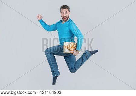 Jumping Handsome Man With Present Box. Businessman Giving Birthday Gift. Energetic Unshaven Man